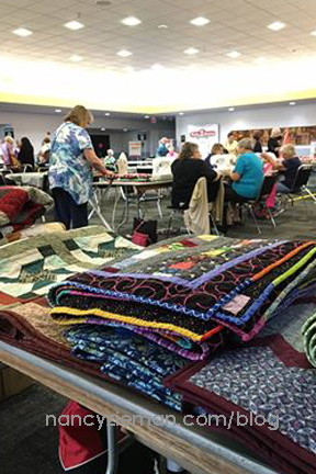 Quilt to Give Community Service Project at Quilt Expo