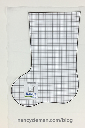 Nancy Zieman's 2016 Christmas Stocking Sewing Challenge. Sew, quilt, or embroider any style of Christmas stocking and enter the contest. Half-Square Triangle Scrappy Patchwork Christmas Stocking by Nancy Zieman | Third Annual Stocking Sewing Challenge | Sewing With Nancy