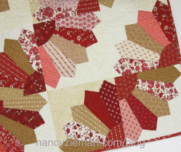 Dresden Fan Quilt by Nancy Zieman featuring the Garnet fabric collection