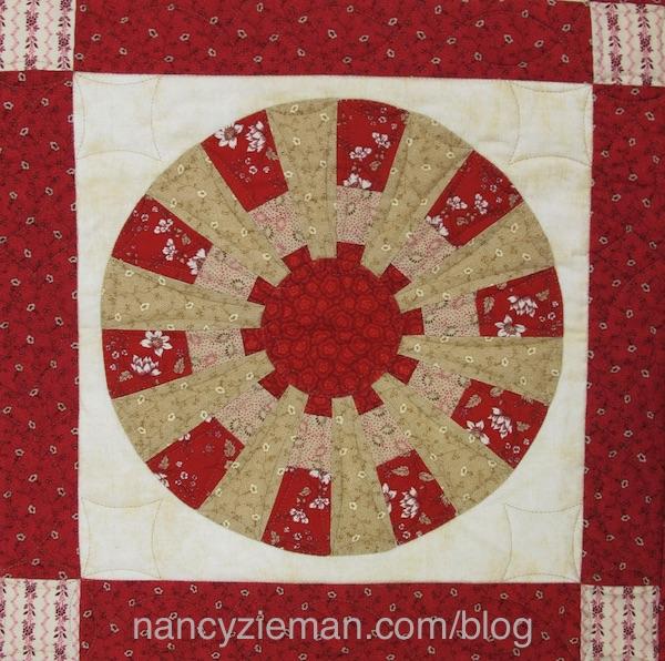 Ferris Wheel Quilt Pattern by Nancy Zieman featuring Garnet Fabric by Penny Rose