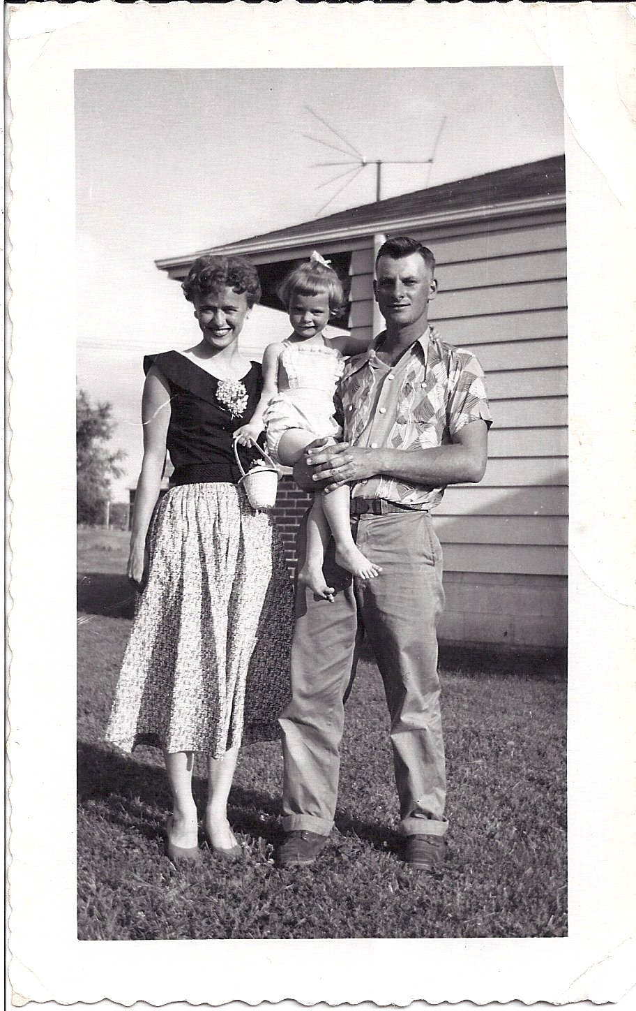 Toddler Nancy Zieman with her Mother and Father in 1956