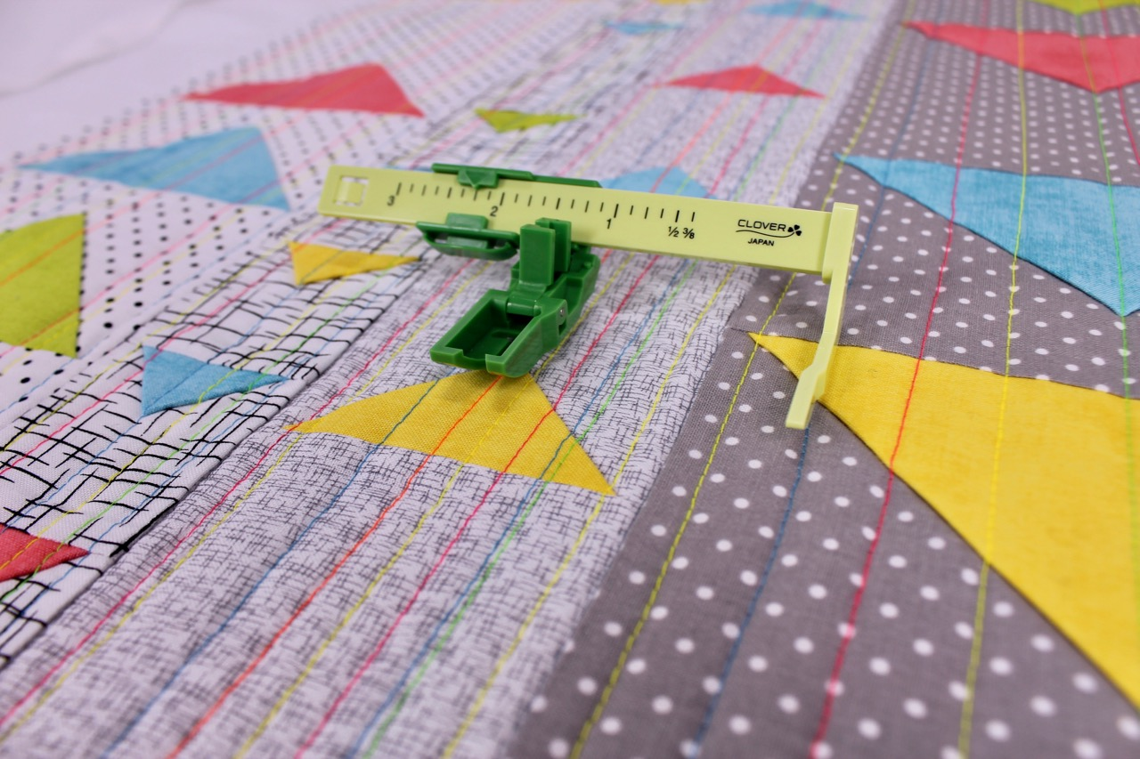 The Ultimate Quilt 'n Stitch Presser Foot by Nancy Zieman for Clover Needlecraft is ideal for straight line machine quilting