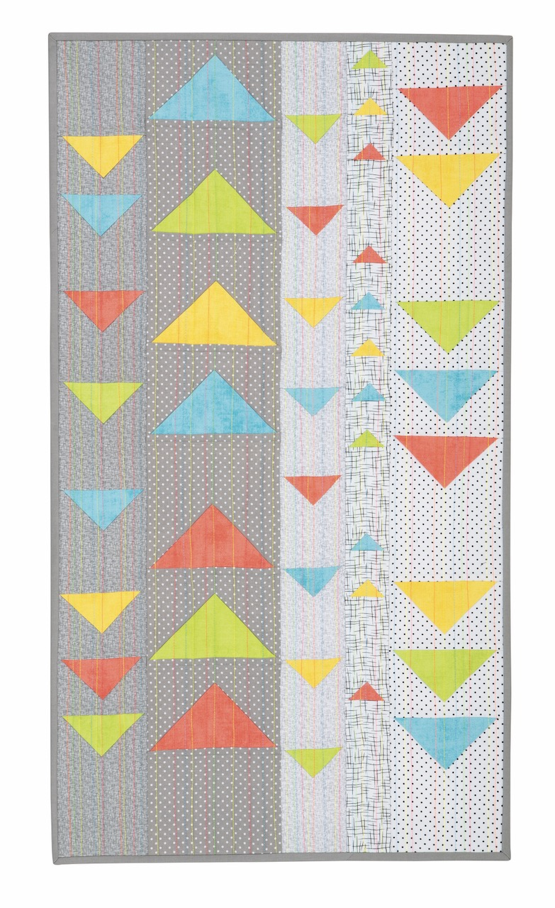 NEW! Modern Floating Triangles Wall Hanging and Table Runner Pattern by Nancy Zieman Productions.