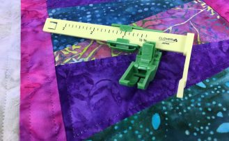 The Ultimate Quilt 'n Stitch Presser Foot by Nancy Zieman Productions, LLC for Clover available at ShopNZP.com
