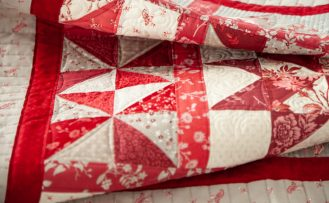 Red Elegance Fabric and Red Elegance Quilt Pattern by Nancy Zieman Productions available at ShopNZP.com