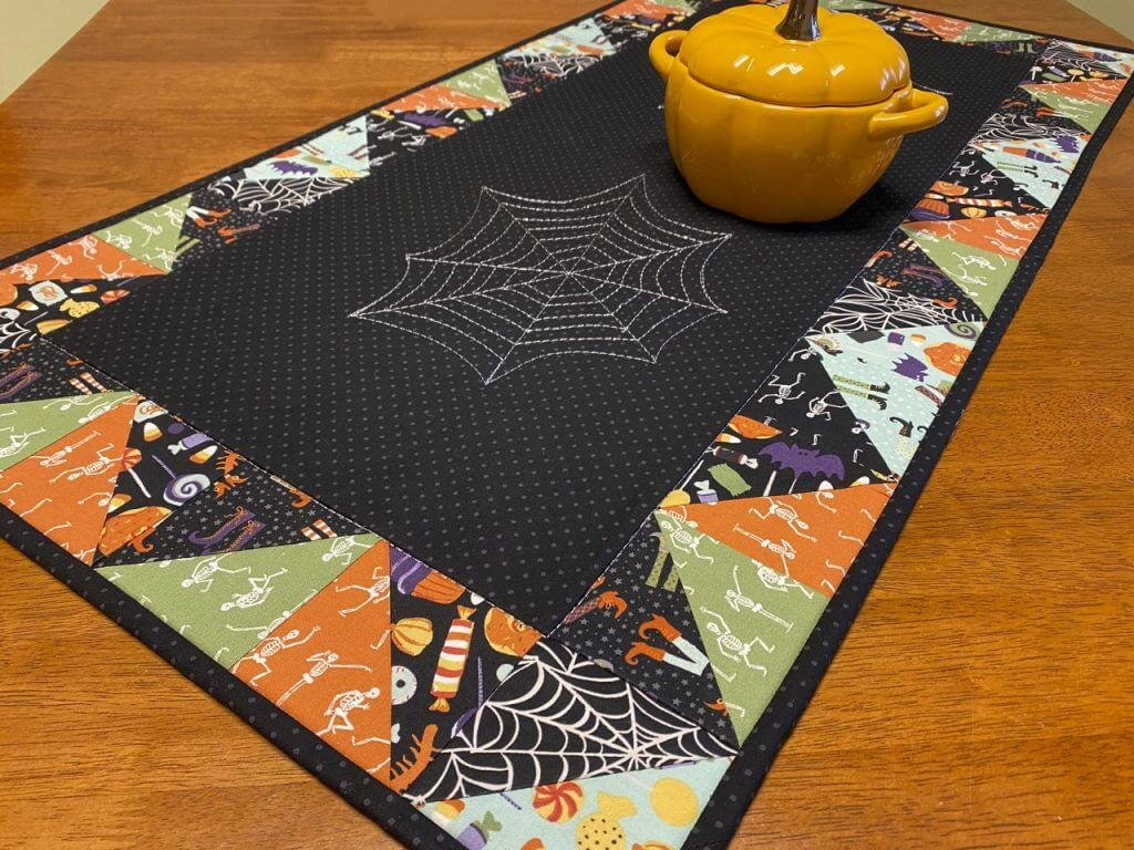 FREE! Spooky Spiderweb Table Runner Sewing Tutorial with FREE! Spiderweb Stitching Printable PDF at The Nancy Zieman Productions Blog