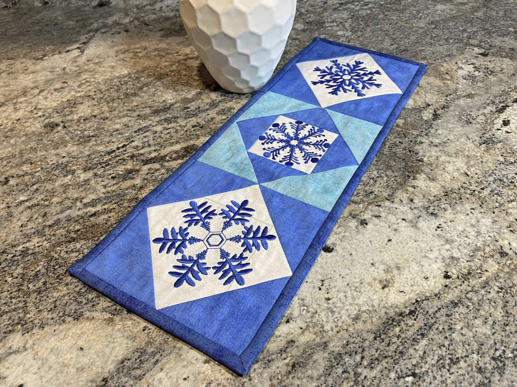NEW! Exclusive Quick Quilting in the Hoop: Winter Snowflakes Embroidery Collection and Book available at Nancy Zieman Productions at ShopNZP.com