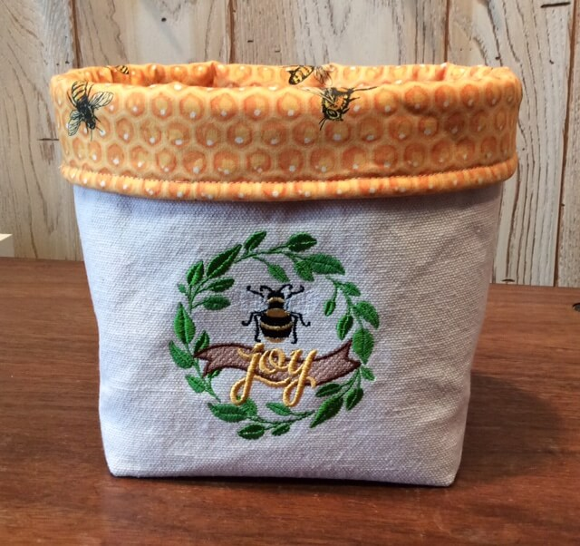 https://nancyzieman.com/blog/stitch-it-sisters/fun-fabric-caddy-sewing-tutorial-and-new-wildflower-boutique-fabric-caddy-bundle-boxes-at-shopnzp-com/