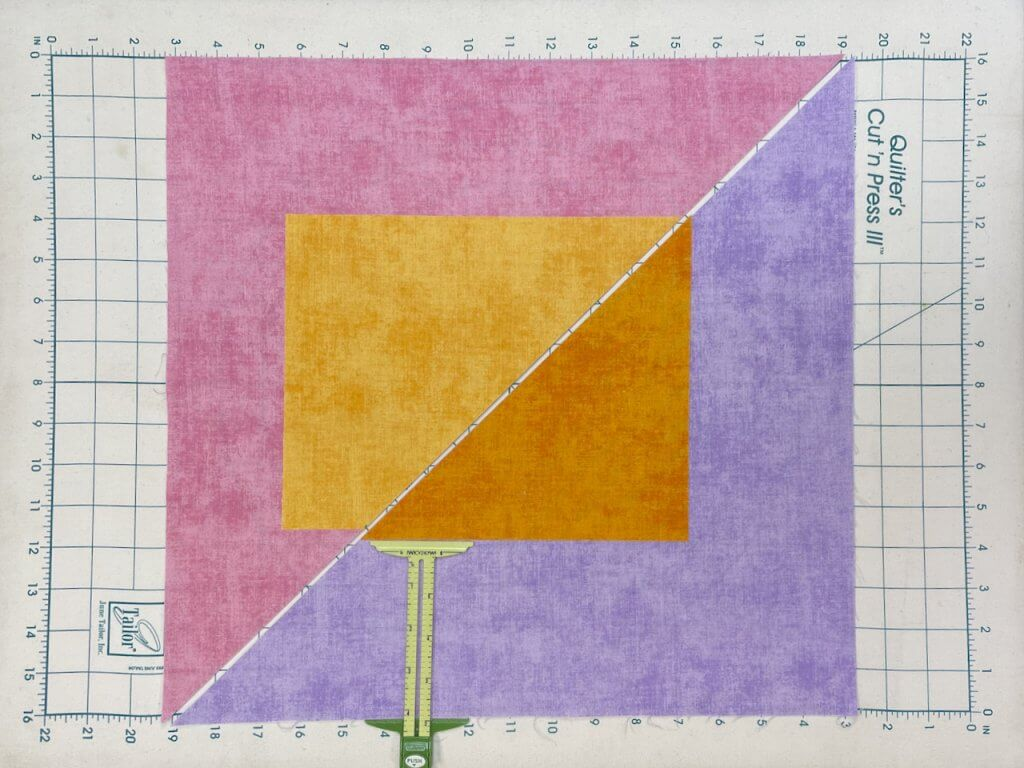 Modern Mini Quilt Sewing Tutorial by the Stitch it Sisters at The Nancy Zieman Productions Blog
